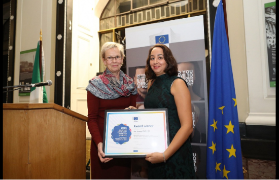Imane Rachidi, Spain receives her award from Tiina Astola, Director-General for Justice and Consumers